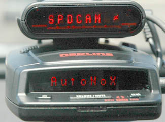 Escort Passport RedLine radar detector with Escort Passport SC55 alerts to red light camera ahead.