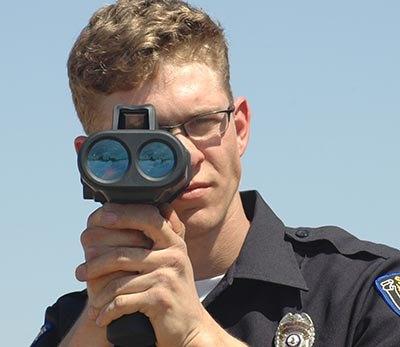 Officer aiming Laser Ally laser